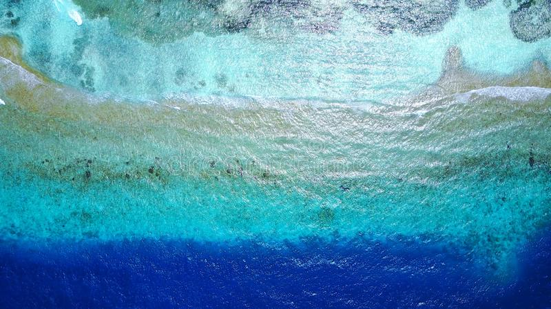 P02690 Aerial flying drone view of Maldives white sandy beach abstract waves water surface texture on sunny tropical stock image