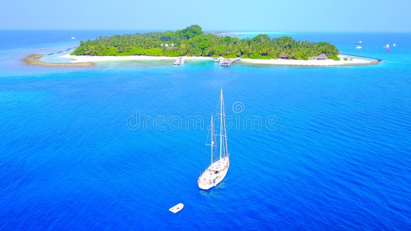 P00022 Aerial flying drone view of Maldives white sandy beach on sunny tropical paradise island with aqua blue sky sea water ocean. Aerial flying drone view of royalty free stock photos