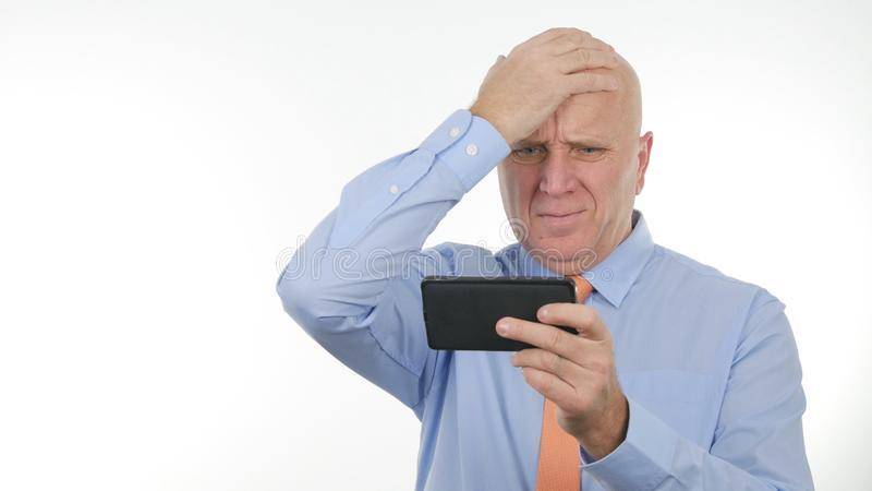 Disappointed Businessman Reading Cellphone Bad News Make Nervous Hand Gestures. Disappointed Businessperson Reading Cellphone Bad News Make Nervous Hand Gestures stock photo
