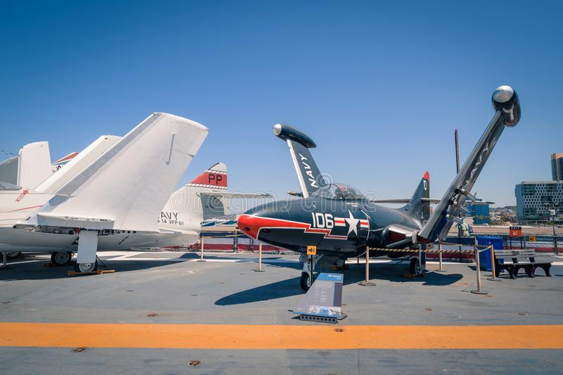 P9F Panther Fighter plane on USS Midway aircraft carrier museum at the San Diego Harbor California clear summer day. The USS midway is a retired aircraft carrier royalty free stock photography