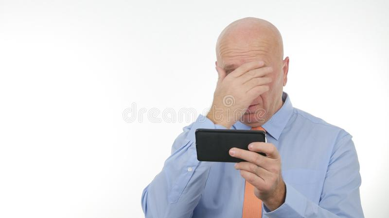 Disappointed Businessman Reading Cellphone Bad News Make Nervous Hand Gestures. Disappointed Businessman Read Cellphone Bad News and Make Nervous Hand Gestures stock photo