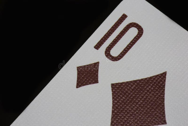 Pôquer de diamantes do macro dos cartões de jogo do casino dos dez fotografia de stock royalty free