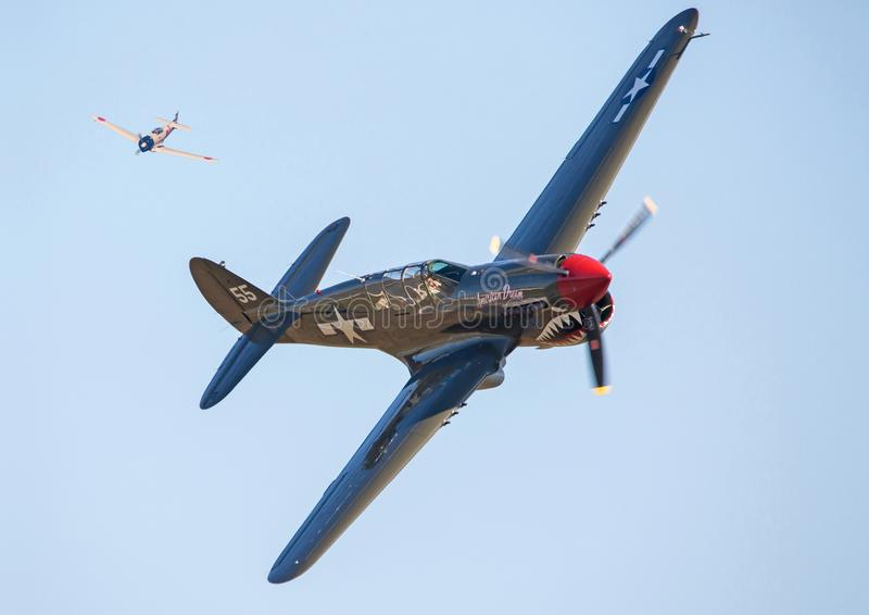 P-40 Warhawk Aircraft in Aerial Combat. A P-40 Warhawk and Japanese Zero fighter aircraft recreate an aerial dogfight in the Pacific Theater during World War II stock photo