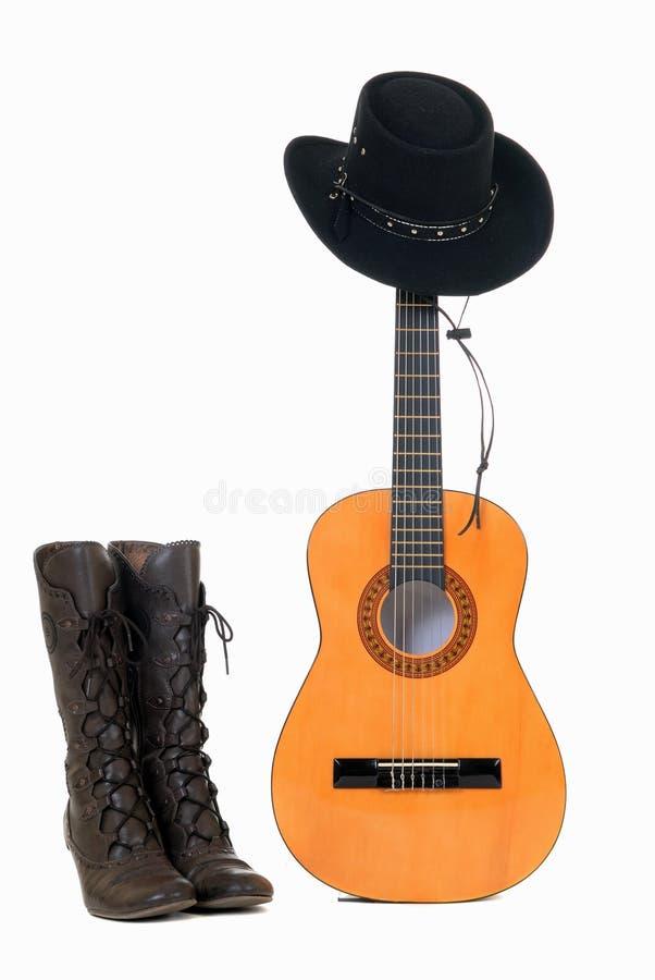 País y sombrero occidental de la guitarra fotografía de archivo