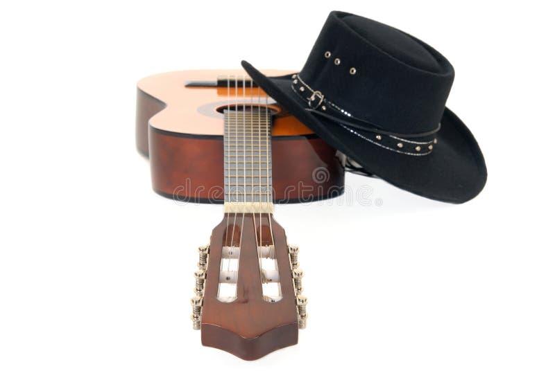 País y sombrero occidental de la guitarra imagen de archivo libre de regalías