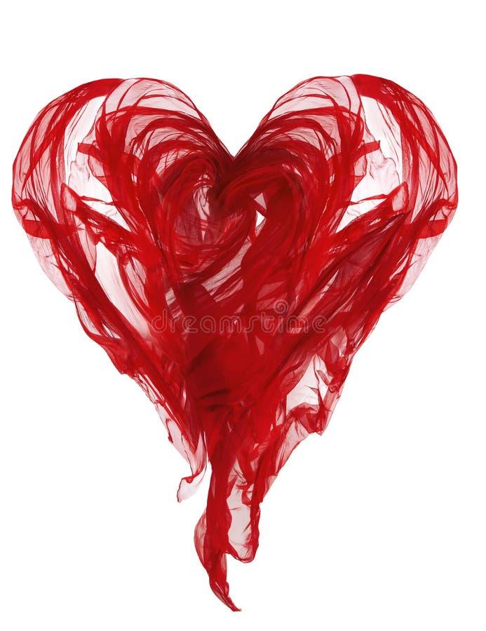 Paño de la forma del corazón, dobleces que agitan de la tela roja, blanco de la materia textil que vuela aislados fotografía de archivo libre de regalías