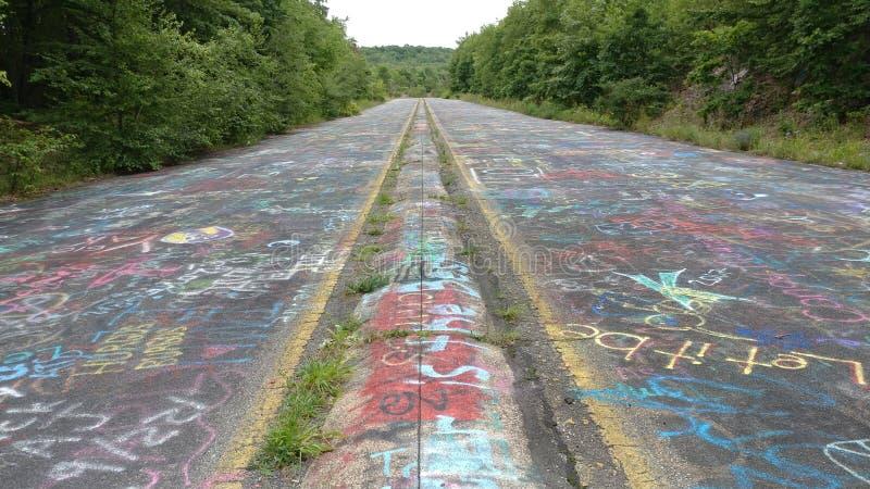 PA de Centralia - estrada dos grafittis imagens de stock
