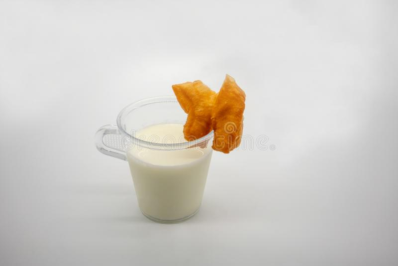 `Pa Thong Ko`, a pair of connected dough fried stick, served with soil milk stock photo
