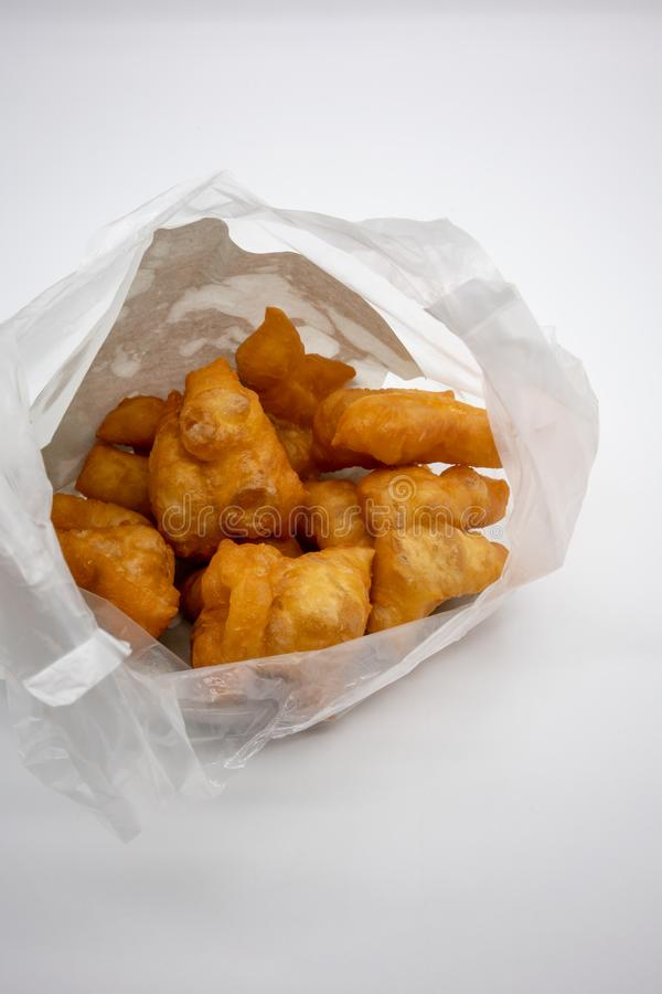 Pa Thong Ko, pair of connected dough fried sticks, in plastic b stock photos