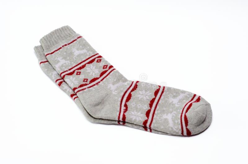 Paar als thema gehade sokken van vrouwen Kerstmis in grijs en rood royalty-vrije stock afbeelding