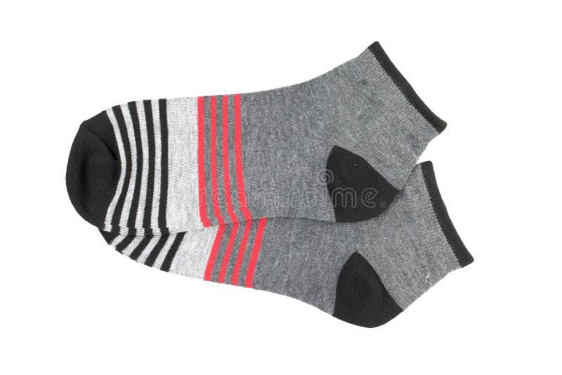 Paar gestreepte die sokken op een witte achtergrond worden geïsoleerd stock afbeeldingen