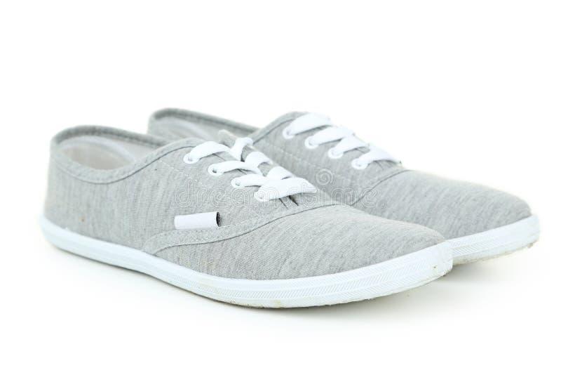 Paar grijze schoenen stock afbeelding
