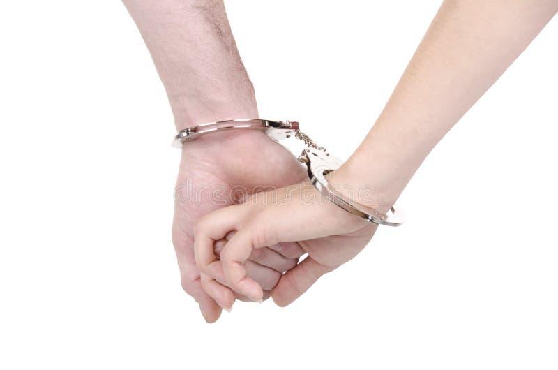 Paar in handcuffs royalty-vrije stock foto's