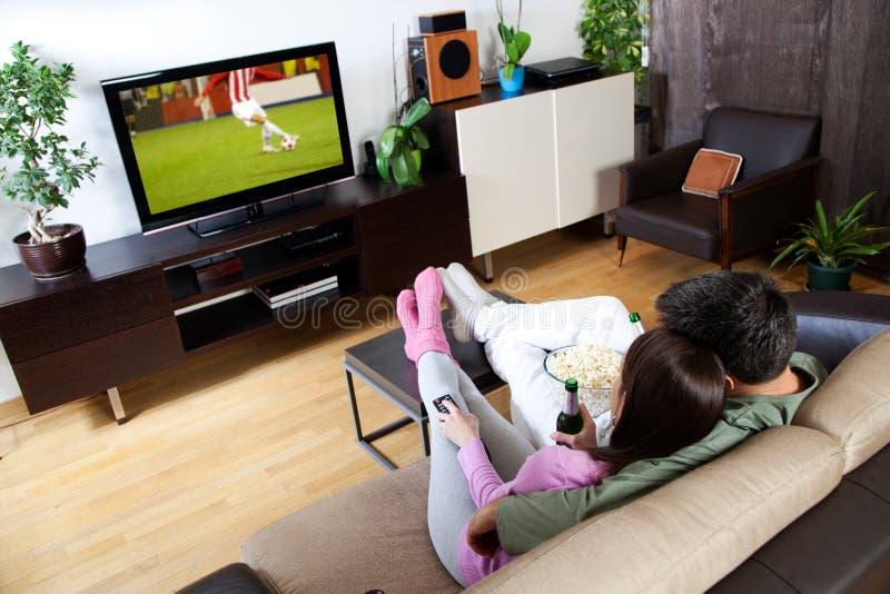 Paar het letten op sport royalty-vrije stock afbeelding