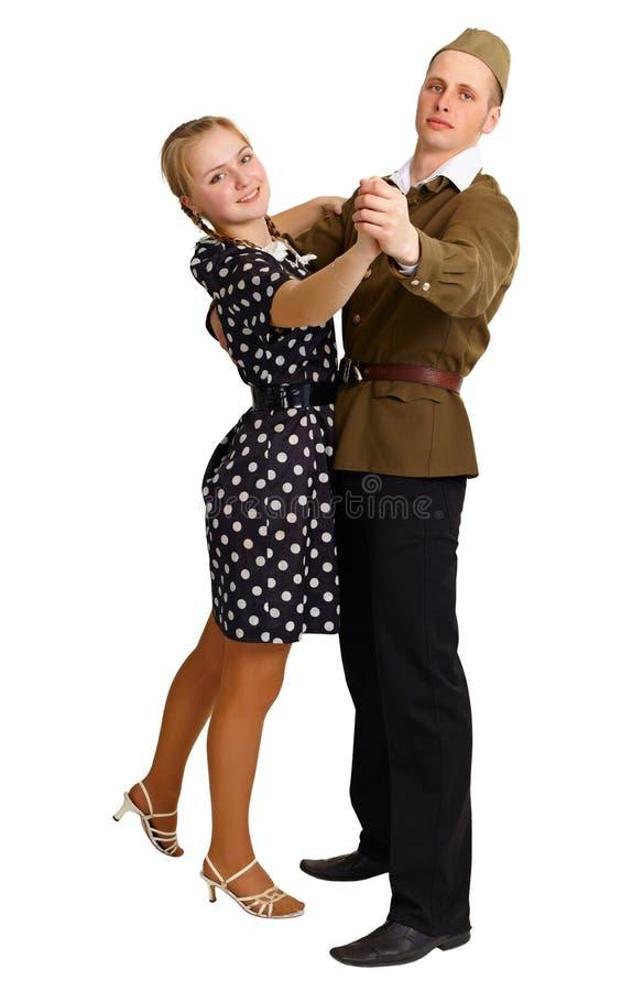 Paar in het ouderwetse kleren dansen royalty-vrije stock afbeelding