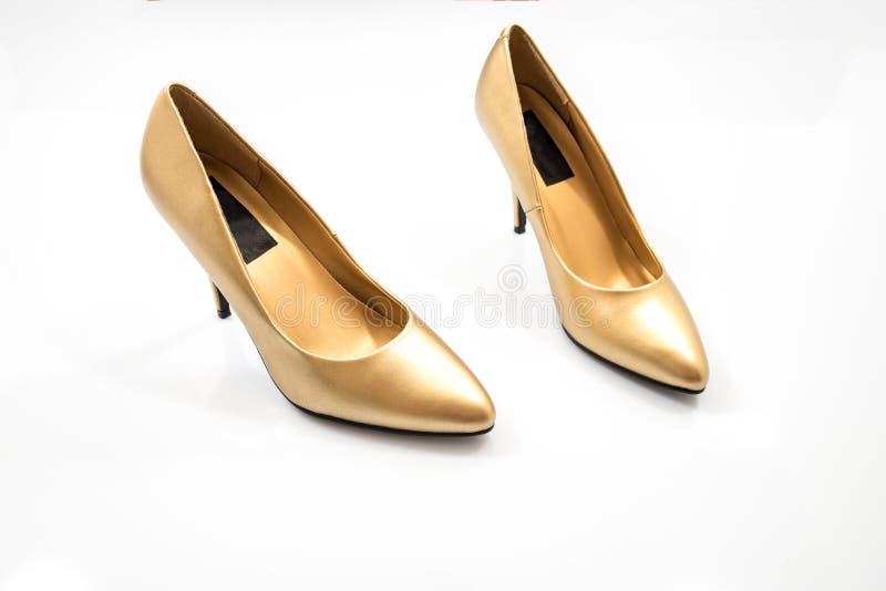 Paar hoge hielen in gouden kleur royalty-vrije stock foto