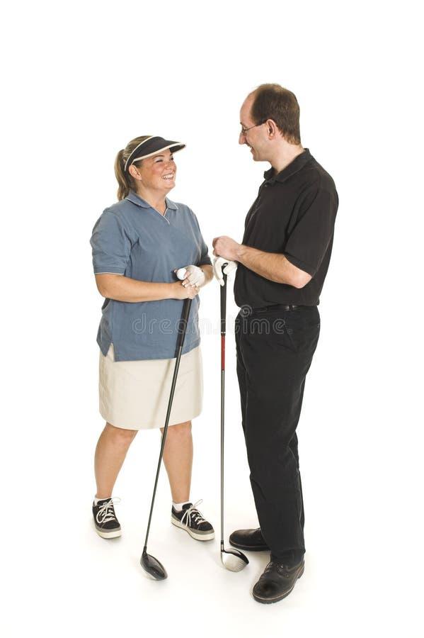 Paar met golfclub royalty-vrije stock afbeeldingen