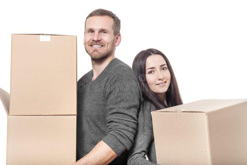 Paar met het bewegen van dozen stock foto's