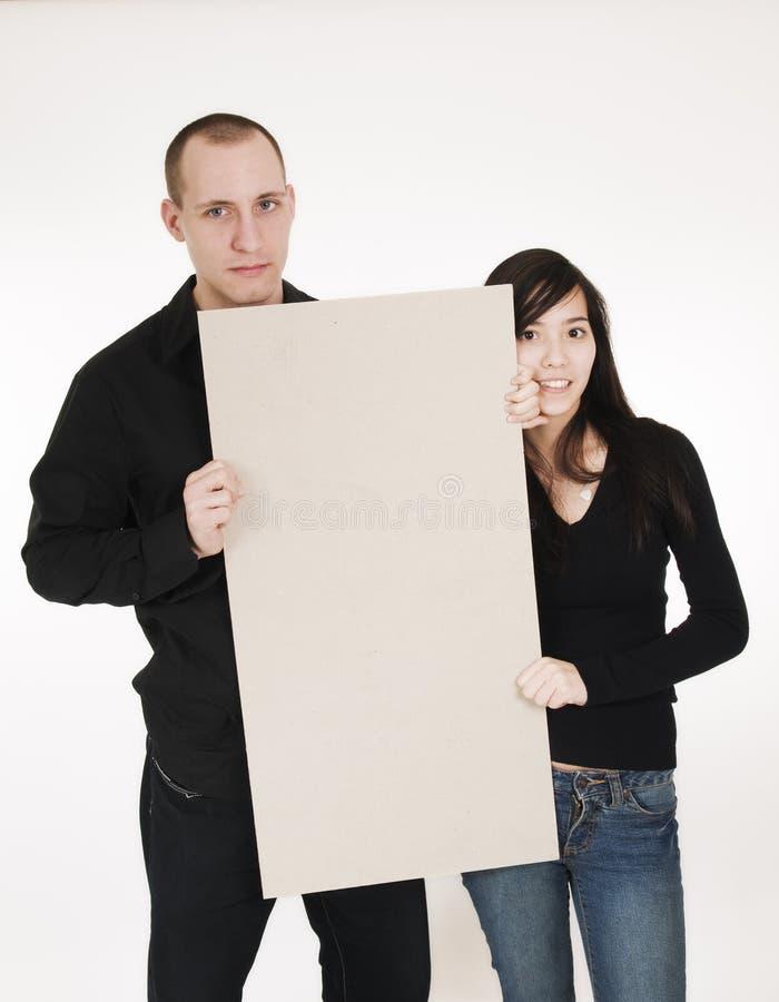 Paar met raadsverticaal stock foto