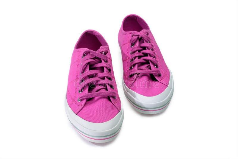 Paar roze gumshoes Fuchsiakleurig die tennisschoenen op een wit worden geïsoleerd royalty-vrije stock afbeelding