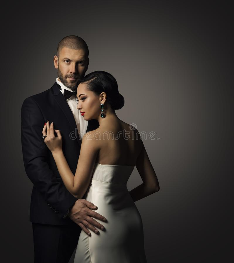 Paar-Schönheits-Porträt, gut gekleideter Mann, elegante Frau lizenzfreies stockbild