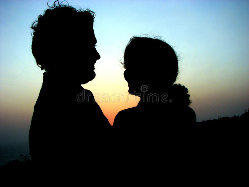 Paar-Sonnenuntergang lizenzfreie stockfotografie