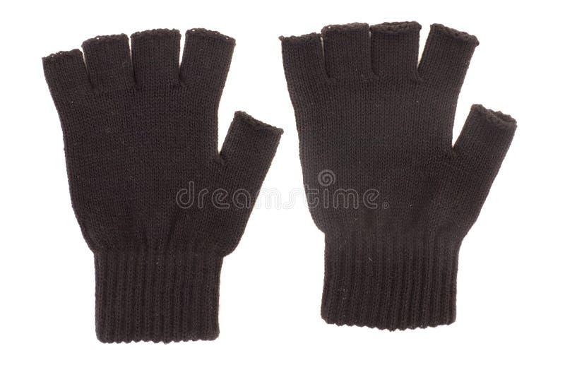 Paar zwarte gebreide handschoenen stock fotografie