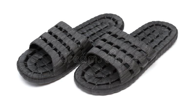 Download Paar Zwarte Plastic Pantoffels Op Wit Stock Afbeelding - Afbeelding bestaande uit pantoffels, schoenen: 107706583