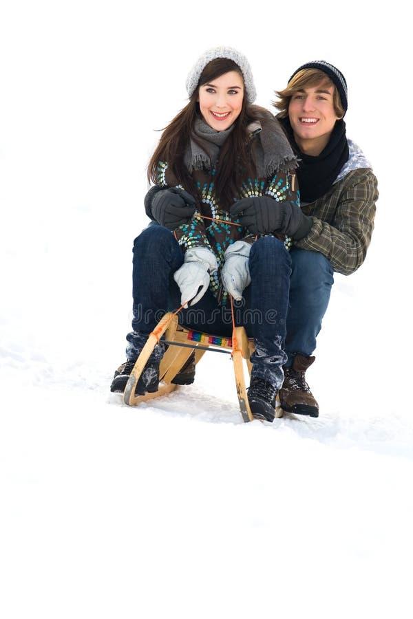 Paare auf Schlitten stockbild