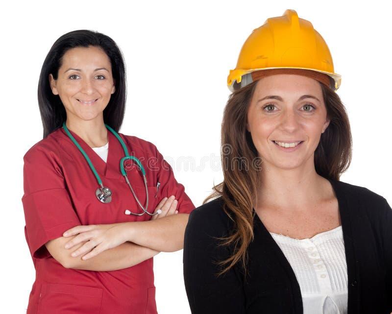 Paare der Arbeitnehmerinnen lizenzfreie stockfotos