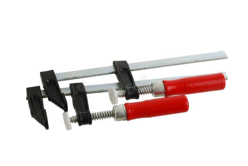 Paare der metallischen Rohrschellen mit rotem Griff lizenzfreies stockbild