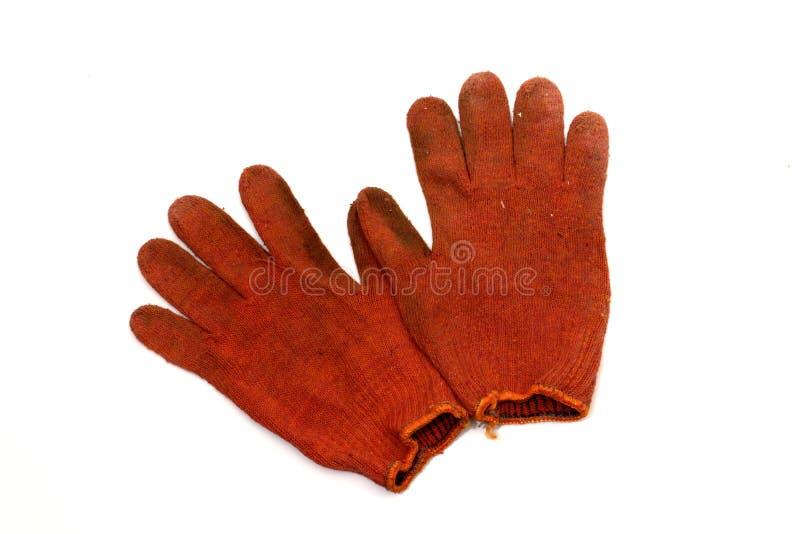 Paare der orangeroten arbeitenden gestrickten Handschuhe, gedrehtes Innere - heraus stockbilder