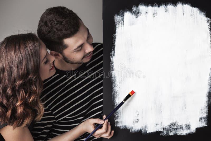 Paare mit Pinseln stockfotos