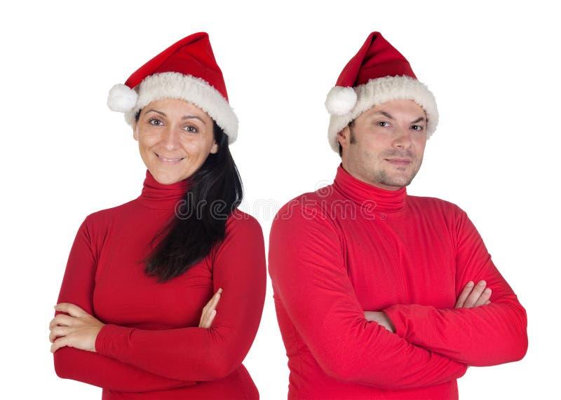 Paare mit roter Kleidung im Weihnachten lizenzfreies stockfoto