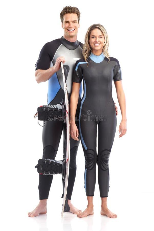 Paare mit Surfbrett lizenzfreies stockbild