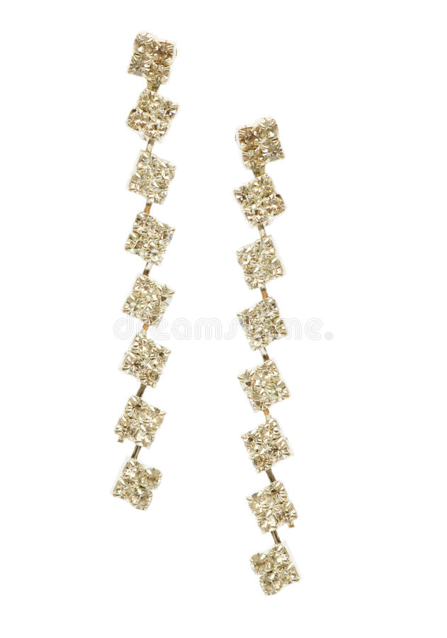Paare Ohrringe getrennt auf dem Weiß lizenzfreies stockfoto