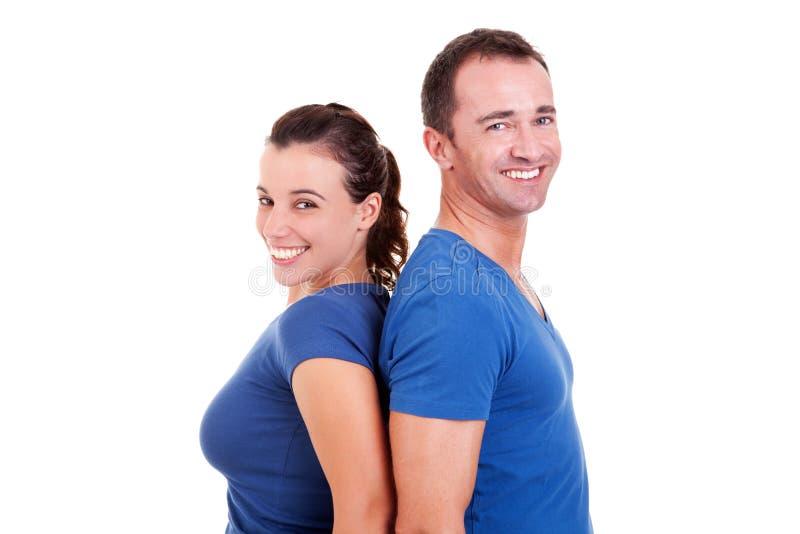 Paare zurück zu dem rückseitigen Lächeln stockfotografie