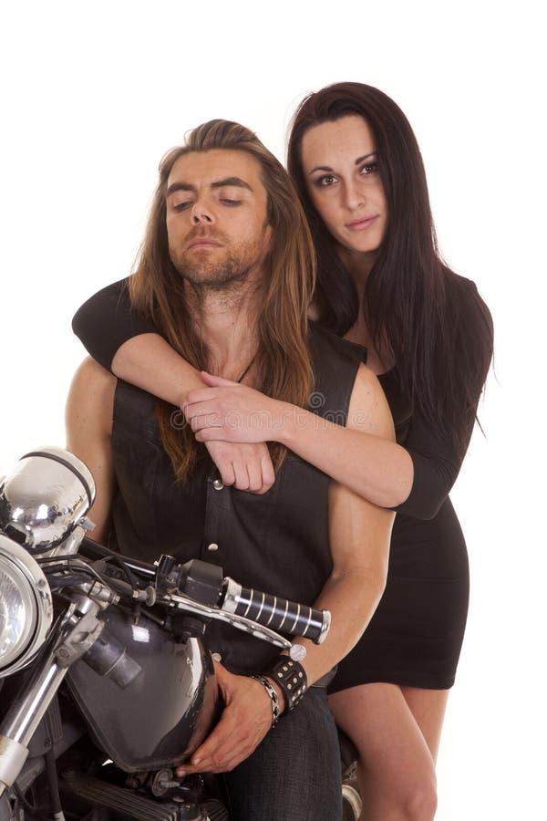 Paarmotorrad-Abnutzungsschwarzes ihr Blick stockfotos