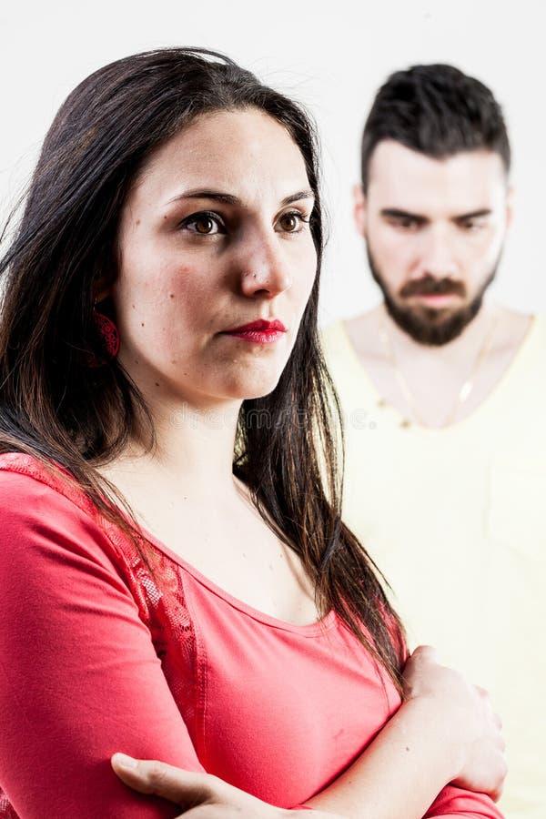 Paarproblemen met vrouw op voorgrond royalty-vrije stock afbeeldingen
