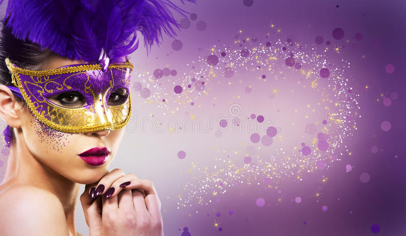 Paarty woman swearing golden mask on light backgound stock images