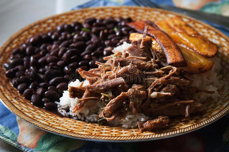 Pabellón Criollo traditional venezuelan dish. Traditional Venezuelan dish Pabellon Criollo. White rice,Shredded Beef, Black beans, Fried Plantains. Lunch time royalty free stock images