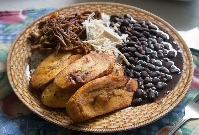Pabellón Criollo traditional venezuelan dish. Traditional Venezuelan dish Pabellon Criollo. White rice,Shredded Beef, Black beans, Fried Plantains. Lunch time stock image