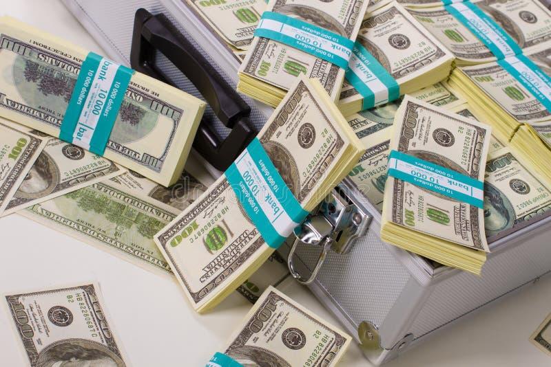 Download Pacchetti dei dollari fotografia stock. Immagine di investimento - 56881818