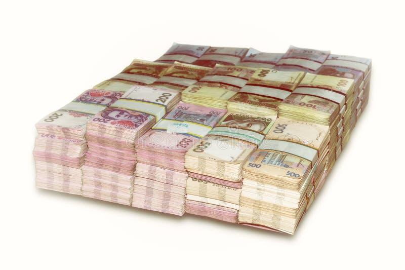 Pacchetti ucraini del dei soldi impilati immagini stock