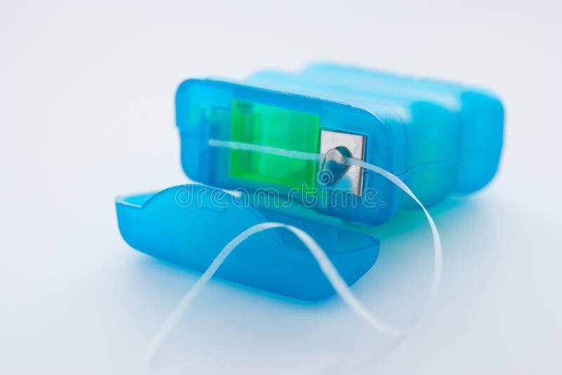 Pacchetto di filo per i denti fotografia stock
