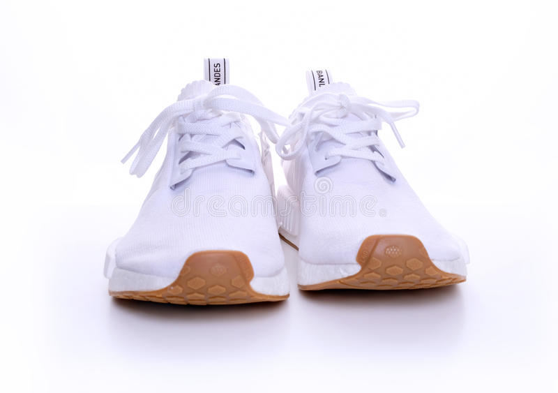 Pacchetto originale della gomma di Adidas NMD R1 tutto il bianco fotografia stock libera da diritti