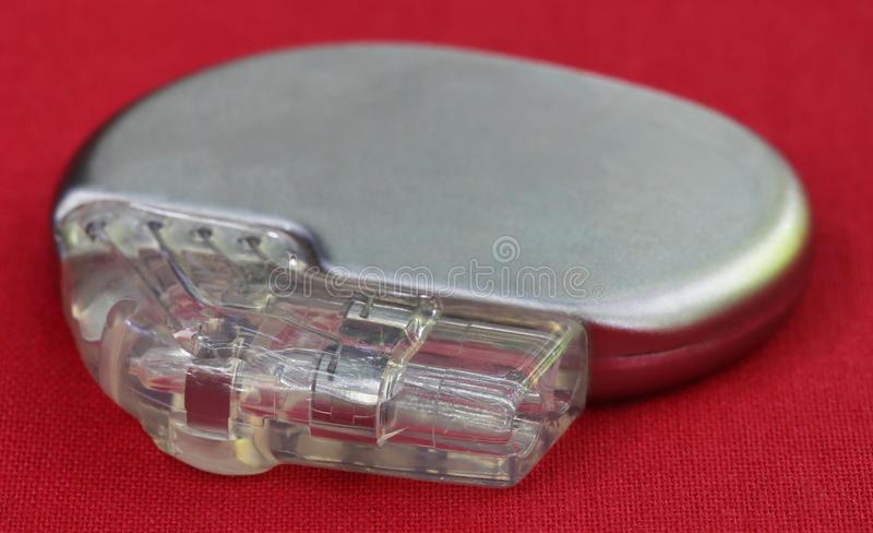Pacemaker. On a red surface stock photo