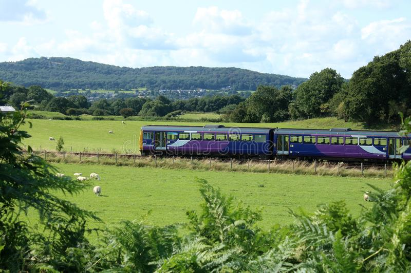 Pacer diesel multiple unit train in countryside. Class 142 Pacer diesel multiple unit passenger train in old Northern livery seen in the countryside on the royalty free stock photos