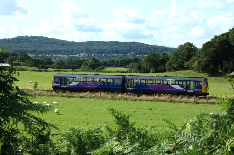 Pacer diesel multiple unit train in countryside. Class 142 Pacer diesel multiple unit passenger train in old Northern livery seen in the countryside on the stock images