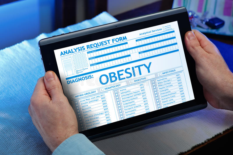 Paciente com um diagnóstico da obesidade no relatório médico digital imagens de stock royalty free